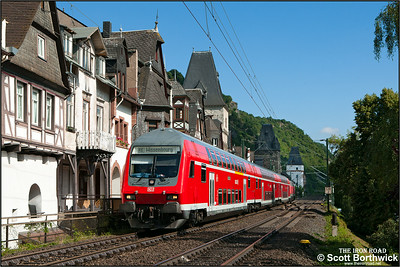 The summer Sundays only RE18849 0930 Koblenz Hbf-Wissembourg is propelled by 218 414-1 passing Bacharach on 06/07/2014.