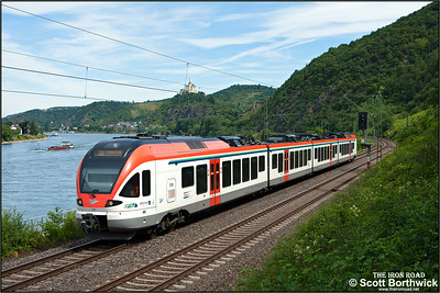 VIAS Stadler FLIRT (Fast Light Innovative Regional Train) EMU, 410 forms the 1037 Neuweid Hbf-Frankfurt (Main) Hbf service on 07/07/2014 along the east bank of the River Rhine south of Braubach.