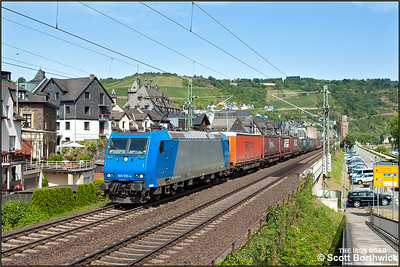 Bombardier TRAXX F140 AC1, 185 515-4 owned by Alpha Trains (Antwerp) and on hire to Railtraxx BVBA, passes Oberwesel with a southbound intermodal train on 04/07/2014.