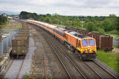 Class 201, number 212 passes Limerick Junction with the 1040 FSaO Dublin Heuston-Cork on 10/06/2005. Note the stored sugar beet wagons on the left awaiting the start of the new season in October.