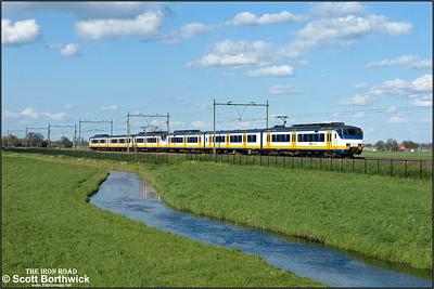 A pair of Nederlandse Spoorwegen (NS) SGMm 'Sprinter' electric multiple units, 2970+2939 pass Moordrecht whilst forming RE4063 1612 Uitgeest-Rotterdam Centraal on 30/04/2015.