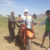 A Mongolian farmer trying the bike on for size.