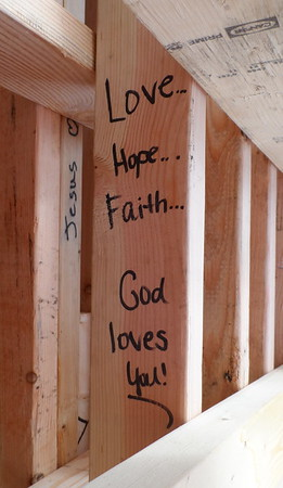 On new home builds, Fuller Center volunteers often write messages of hope and Bible verses on the wood.