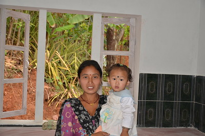 Deepa Tamong and her daughter in Trishuli village, Nepal. Though just 30 miles from the epicenter of the April 2015 earthquake, The Fuller Center's 11 homes in Trishuli all escaped unscathed. Now, The Fuller Center has embarked upon a mission to build 200 more homes in Trishuli and is sharing its building technology with other groups in the country so that they can replicate The Fuller Center's success.
