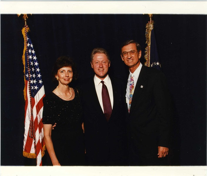 Linda and Millard Fuller pose with President Bill Clinton in 1996 when Millard Fuller was awarded the Presidential Medal of Freedom.