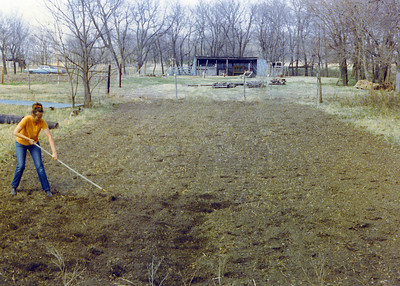 Jay raking garden on Land 1975