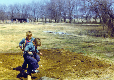 Bobbie & Brian jumping over board on Land 1975