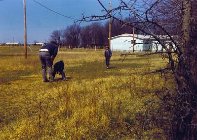 Dad & Bobbie & Brian playing football 2 on Land 1975