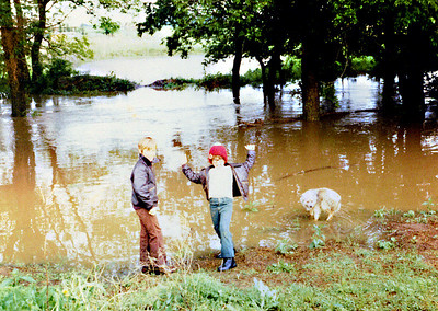 Bobbie & Brian & Buger Bear in front of flooded Creek & Pond 1975
