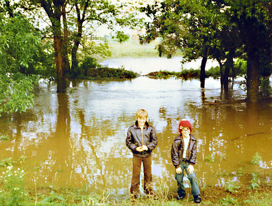 Bobbie & Brian in front of flooded creek & pond on Land 1975