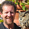 Eurasian Eagle Owl (Bubo bubo) named Mr. Peepers and his handler. This is a 6 month old male owl used for pest control, La Jolla, CA