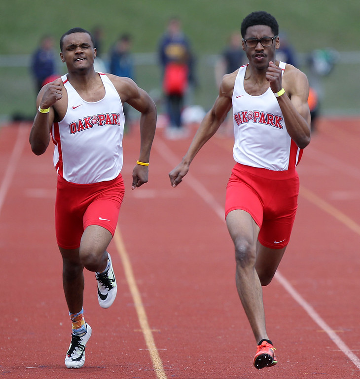 . Donnie James (right) took home first place honors in the 100-yard dash and teammate Dwight Smith (left), came in second during the 56th Annual Elmer Ball Oxford Invitational track meet at Oxford High School Saturday, April 21, 2018. (For The Oakland Press / LARRY McKEE)