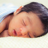 Asian baby boy sleeping on blanket