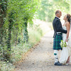 Bride and groom portraits in country lane