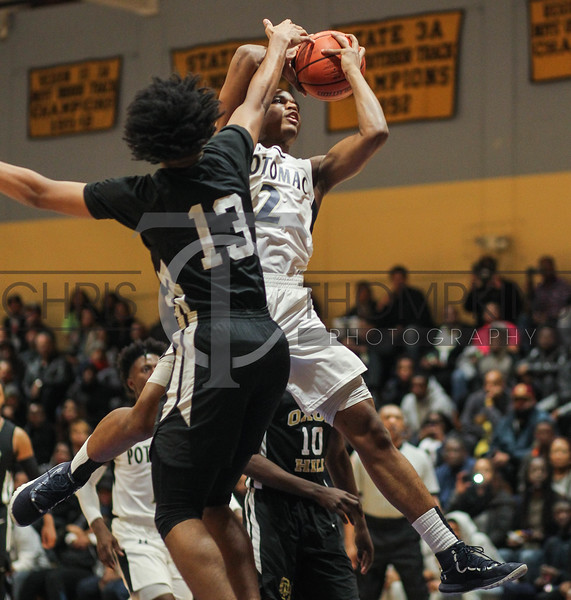 January 11, 2019: Potomac forward Elijah Crawford (2) shoots over Oxon Hill forward Marcus Gorham (13) during HS boys basketball action between Oxon Hill HS and Potomac HS in Glassmanor. Photo by: Chris Thompkins/Prince Georges Sentinel
