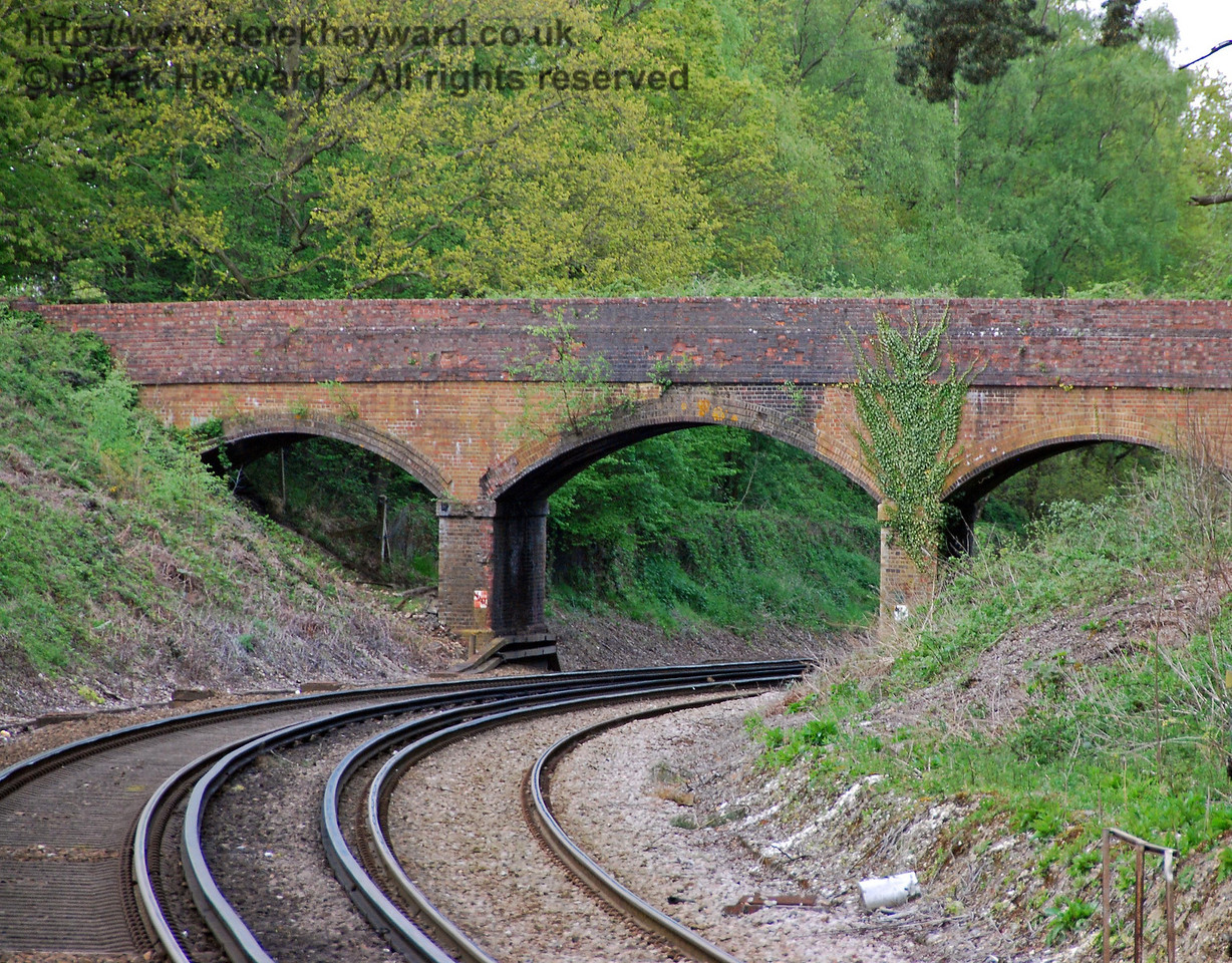 Looking north with a longer lens a small three arch bridge carries a track north west towards a golf course and Lingfield Race Course. 03.05.2008