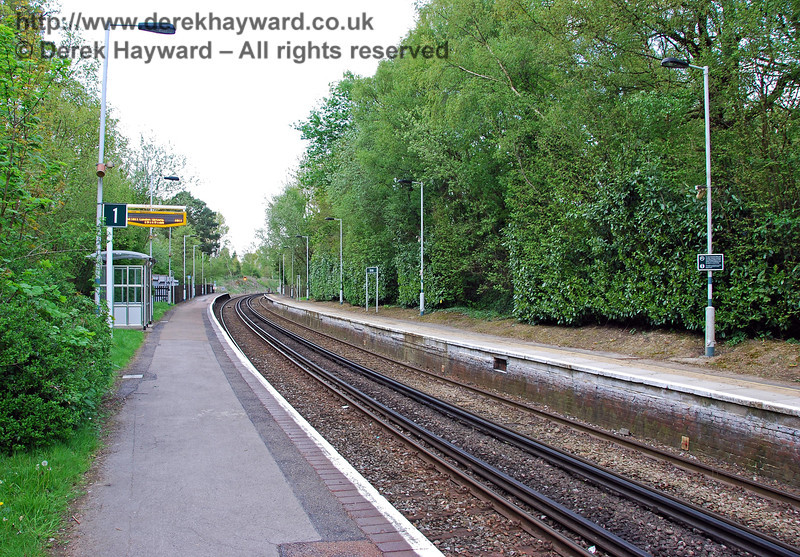 Further down the platforms, a second view north at Dormans Station in 2008. There are small shelters on the platform, but the facilities for adverse weather are not generous. 03.05.2008