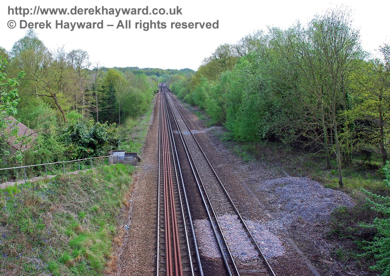 Looking south from the bridge in Dormans Park estate.  In the distance is the top of Cooks Pond Viaduct. 03.05.2008