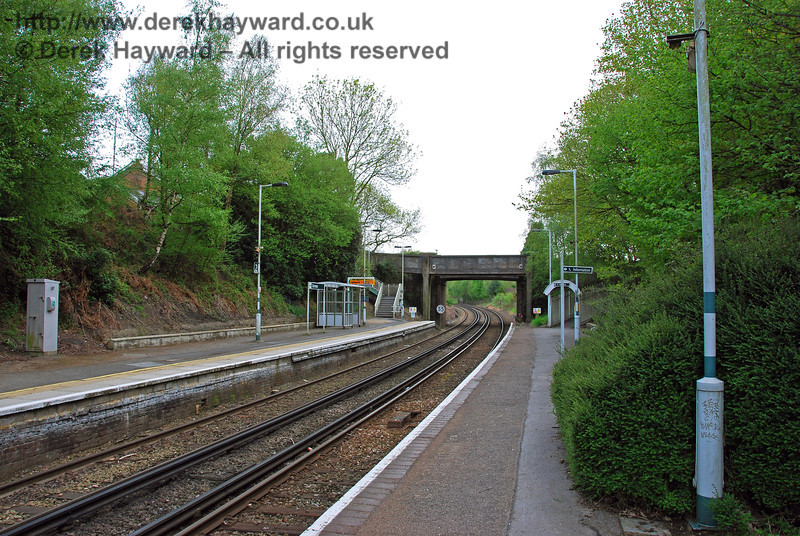 Looking south at Dormans Station. The wider section of tarmac denotes the point at which the steps from the old footbridge from the back of the station building came down to platform level. A gentleman's toilet also stood there, but such facilities no longer exist. 03.05.2008