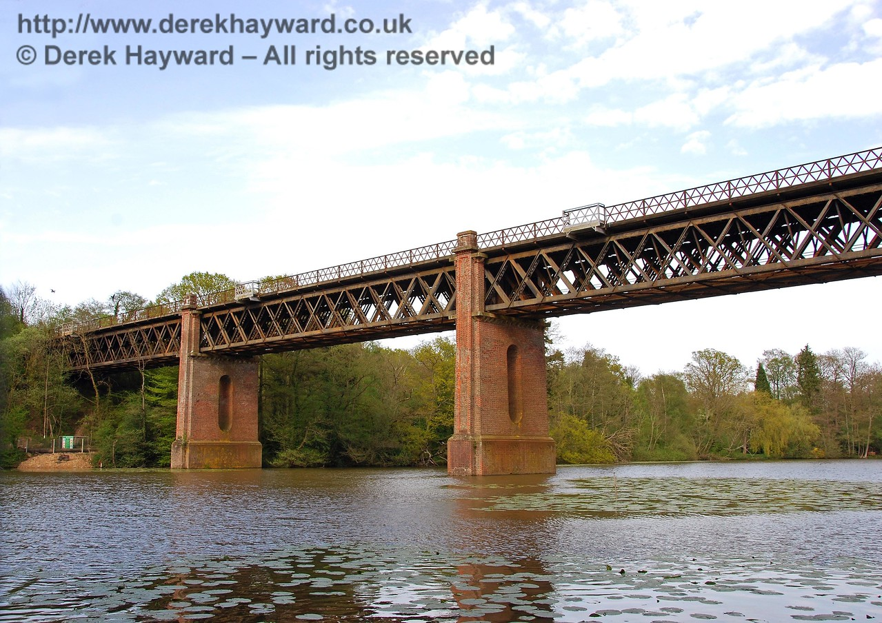 South of Dormans Station is the very impressive Cooks Pond Viaduct, this view looking north.  Although the picture suggests a huge river the water is actually a large private fishing pond. 03.05.2008