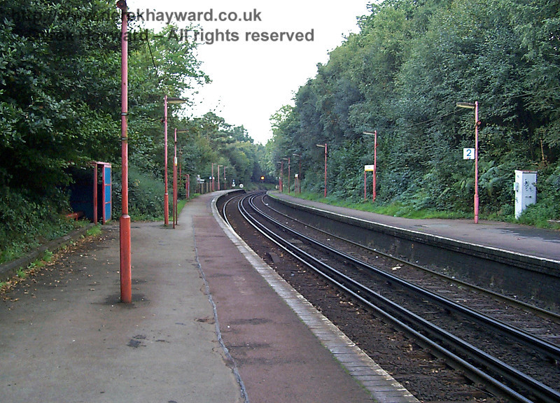 Looking back ten years to 1998 from the same viewpoint. There are no adequate shelters, the platform is overgrown, and the lamps are in dire need of a coat of paint. Things have improved under Southern; at least in 2008 the station looks tidy. 27.09.1998