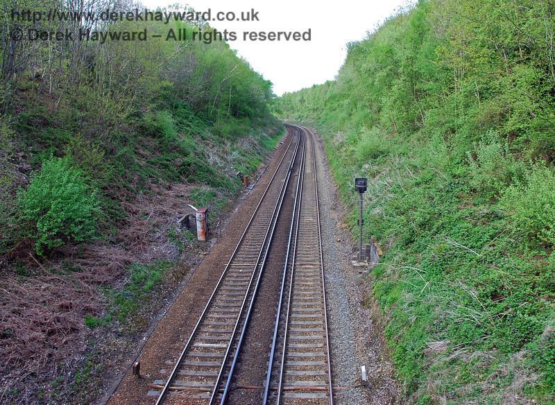 The private estate of Dormans Park justified it's own siding, which was located half a mile south of Dormans Station on the Up side.  This view looks north from the bridge in the Dormans Park estate. 03.05.2008
