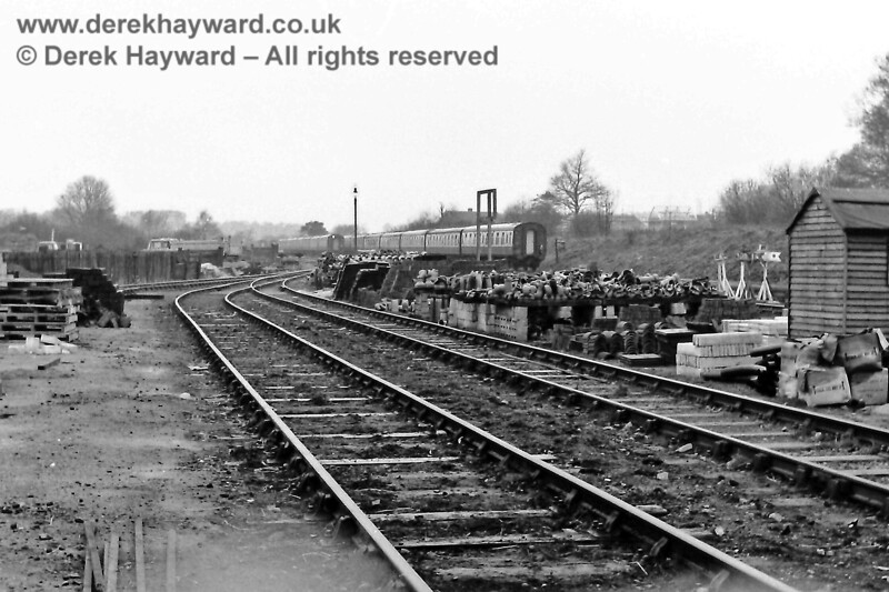 Going back even further, East Grinstead goods yard on 30 March 1969, looking south towards the viaduct, on which coaches can be seen in the sidings. In those days the track had been lifted south of the viaduct, but the viaduct itself carried two sidings that held the locomotive hauled coaching stock.  It is possible that the presence of these sidings helped the viaduct to escape demolition.  Eric Kemp retains all rights to this image.