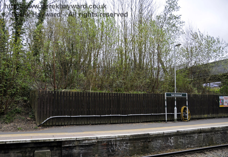 Looking east, the fence denotes the spot where the old bridge for the now demolished High Level Station used to cross the line.  East Grinstead Station, Network Rail.  05.04.2014  10162