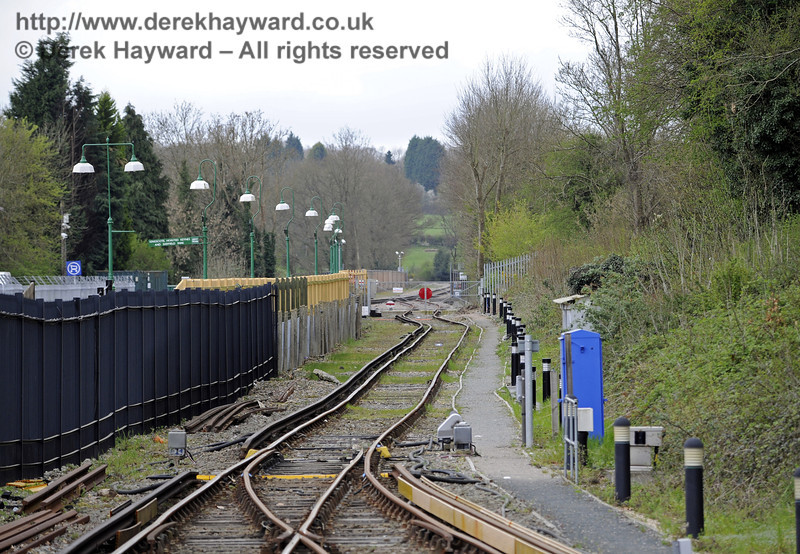 Looking south down the Network Rail headshunt, which runs behind the Bluebell Railway station and gives access to Bluebell tracks.  Viewers are invited to guess the function of the blue apparatus case (there is a clue elsewhere in the collection).  East Grinstead Station, Network Rail.  05.04.2014  8838