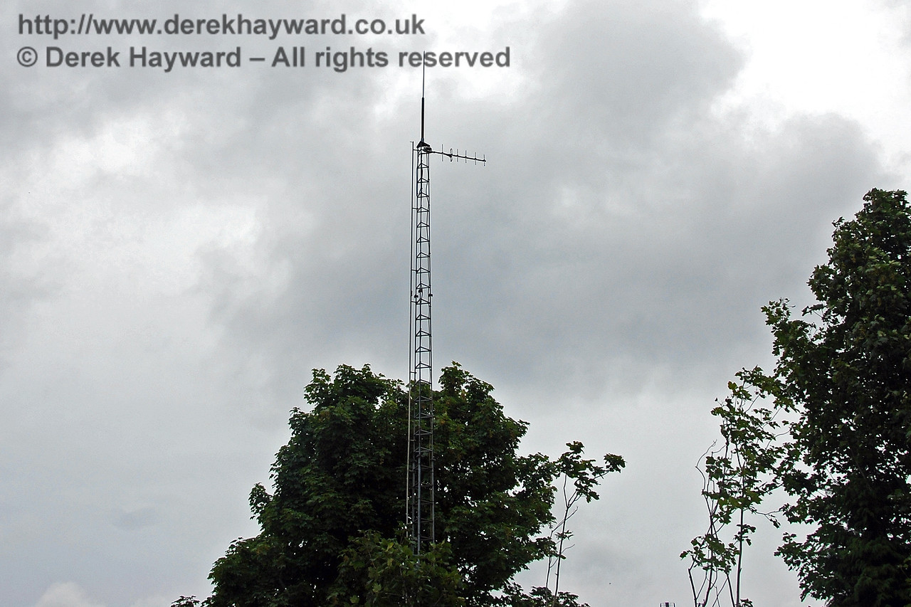 Unusually the Cab Secure Radio mast at East Grinstead is not adjacent to the track, being located instead in the car park which is on the site of the former High Level station.   The antenna points north, suggesting that Bluebell has not yet embraced the CSR system.  26.07.2009  0123