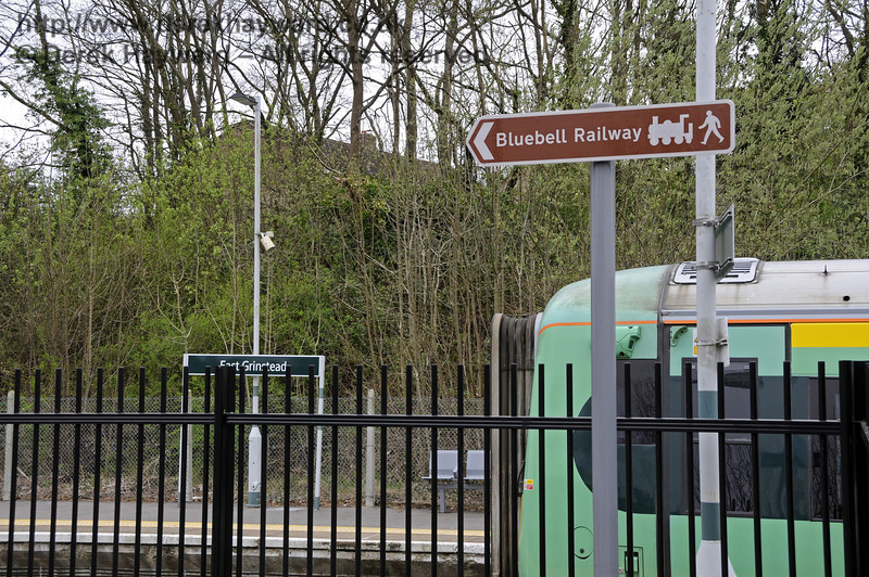 On the south side of the building are signs directing passengers to the Bluebell Railway station.  East Grinstead Station, Network Rail.  05.04.2014  10176