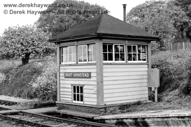"East Grinstead South signal box stood at the southern end of the northbound Low Level platform (where signal OD43 is sited in a previous image). It was pictured on 21 May 1969 by Eric Kemp, who retains all rights to this image.   To the left of the box is the northern sand drag for ""Up Siding No2"", of which virtually no trace remains except for it's buffers (see later image)."