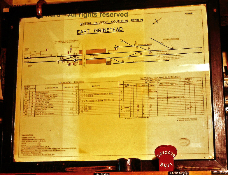 "East Grinstead 'C' (or South) Signal Box diagram, photographed in November 1972 by Eric Kemp, who retains all rights to this image.   Click on the image for a larger version.  I have slightly distorted the colour in an effort to allow the annotations to be read, but unfortunately the quality of the scan is not quite high enough to read everything.  At the southern end the annotations read (from the top) ""Down Siding No2"", ""Down Siding No1"", ""Up Siding No1"" ""Up Siding No2"".  These were the days when both ""No1"" sidings ran on to the viaduct.  The northern sand drag of ""No2"" siding can be seen in the black and white photo above."