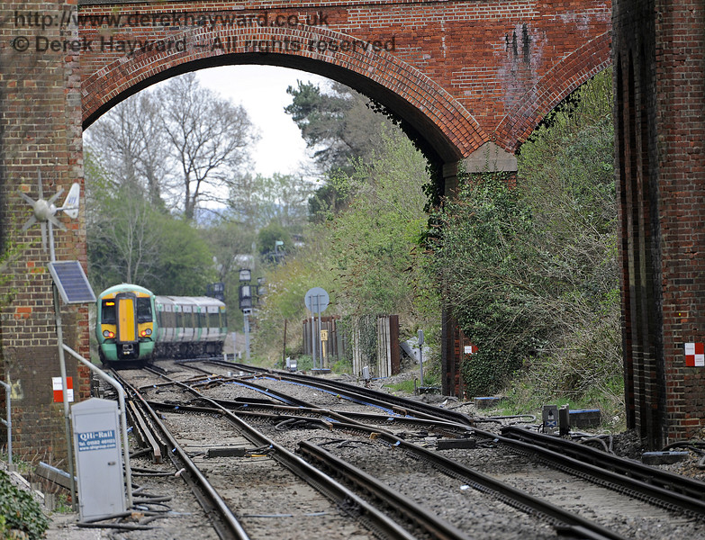 Looking north from Platform 1 with a longer lens as 377462 departs.  East Grinstead Station, Network Rail.  05.04.2014  8846