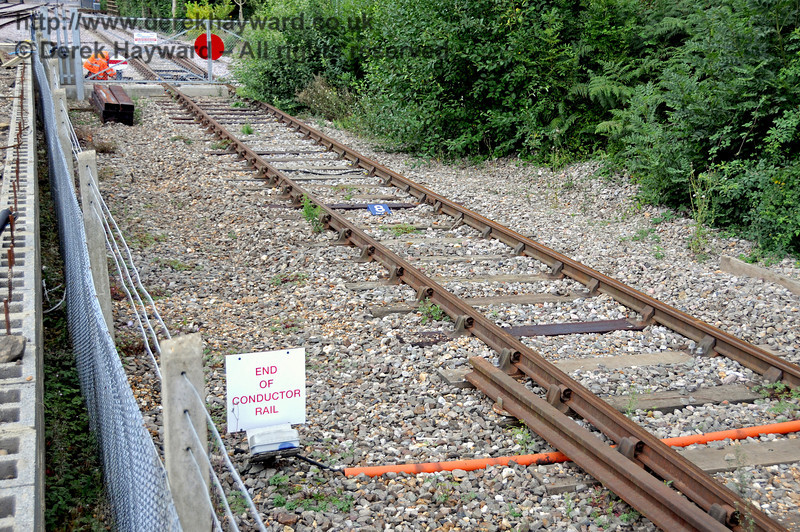 The end of the conductor rail in the Network Rail headshunt.  In the centre of the track a marker for the 8-car stop can be seen.  22.08.2010  4269