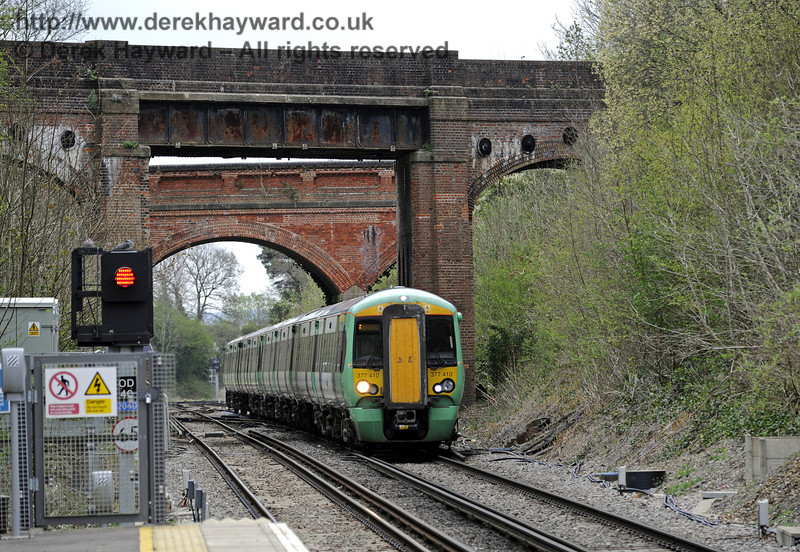Looking north from Platform 1 as 377410 arrives with a terminating service.  East Grinstead Station, Network Rail.  05.04.2014  8853