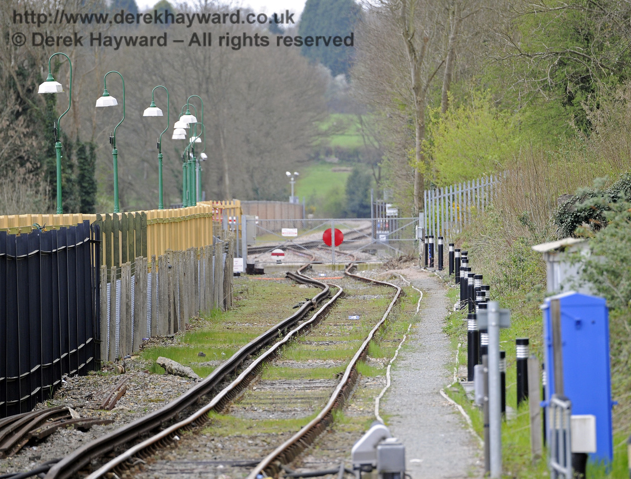 Looking south down the Network Rail headshunt, which runs behind the Bluebell Railway station and gives access to Bluebell tracks.  Although a long lens emphasises any variation in the track, the Bluebell metals in the distance look a tad superior.  East Grinstead Station, Network Rail.  05.04.2014  8837
