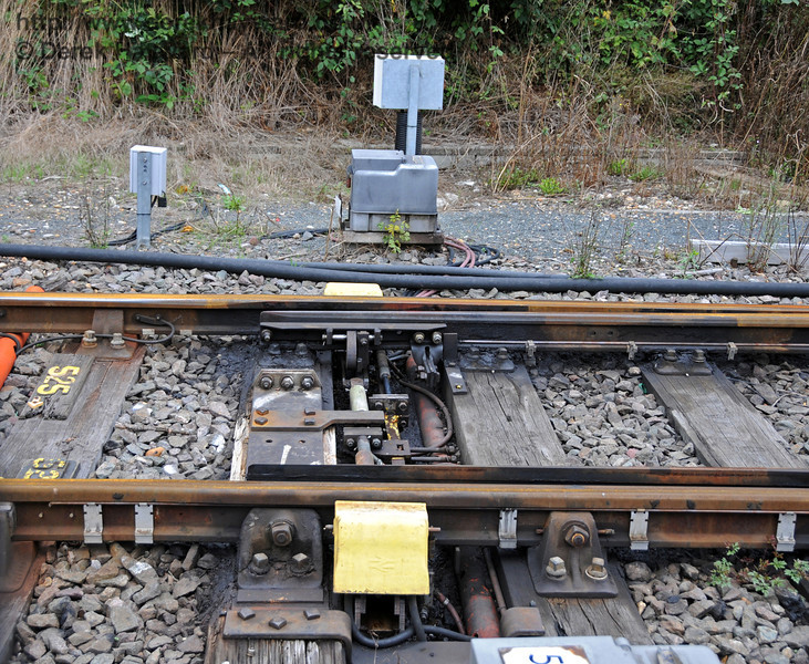 A closer view of the points at the northern end of the headshunt, which normally block traffic by being set in the neutral (centre) position, connected to neither platform. I am advised that these are known as wide to gauge trap points.  East Grinstead 22.08.2010  4259
