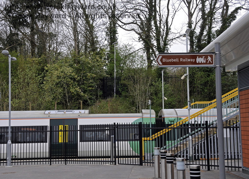 On the south side of the building are signs directing passengers to the Bluebell Railway station.  East Grinstead Station, Network Rail.  05.04.2014  10175