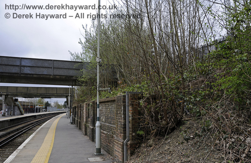 Looking south, the wall denotes the spot where the old bridge for the now demolished High Level Station used to cross the line. East Grinstead Station, Network Rail.  05.04.2014  10163