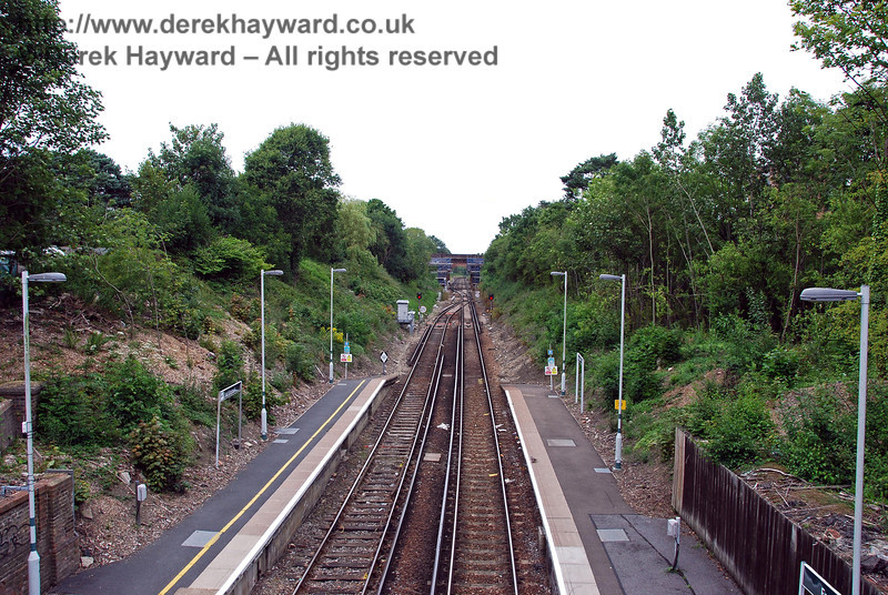 An earlier view north from East Grinstead station, taken from the footbridge which now crosses the line where the original High Level station used to be sited. 26.07.2009  0109