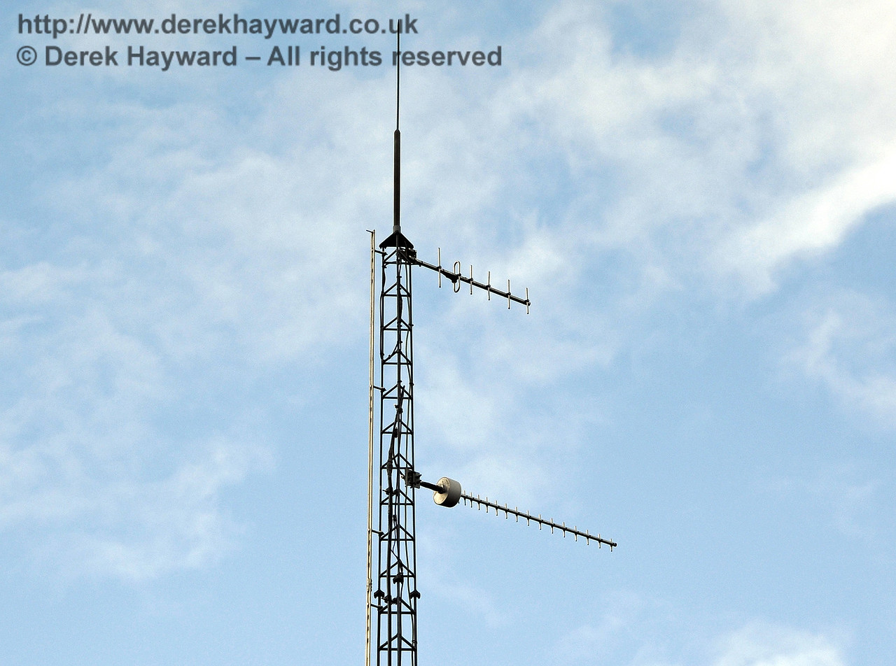 A later view of the same mast, with a GSM-R antenna now erected below the CSR antenna.  This is the replacement radio system which enables the drivers to talk to the signalling centre.  East Grinstead Station, Network Rail.  10.10.2013  8331