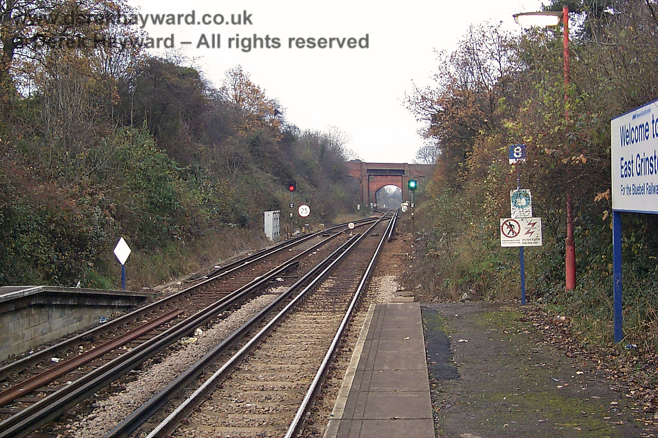 "This old view looks north from Platform 2 on 22.11.1998.  The running in sign on the right says ""Welcome to East Grinstead For the Bluebell Railway"", but the board was removed some time ago.  It would be nice to see a similar running in board reinstated."