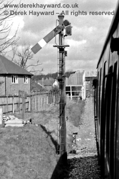 Looking north towards the footbridge from which other images were taken, this is the old Hurst Green Junction Up Home Signal (from Lingfield), pictured on Saturday 12 April 1969.  Eric Kemp retains all rights to this image.