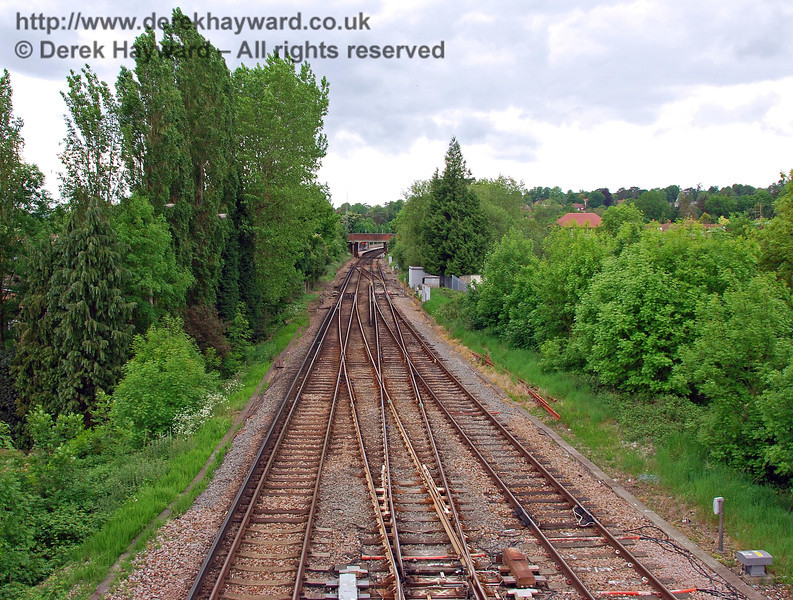 The reverse of the previous view, looking north from the unusually long footbridge which spans both lines south of Hurst Green Junction. Hurst Green Junction signal box originally stood on the left at the point where the two Up lines from East Grinstead and Uckfield join. It has been totally demolished and a small flat area marks the site. 18.05.2008