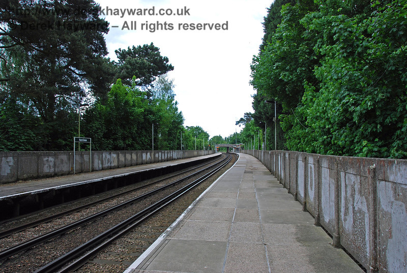 Frankly Hurst Green Station is a depressing environment, with a sea of concrete typical of the period in which it was constructed. At least the adjacent trees provide some relief and as yet the station has been spared the terrible security fencing evident at Oxted.  This view looks south from the northern end of the northbound platform. 18.05.2008