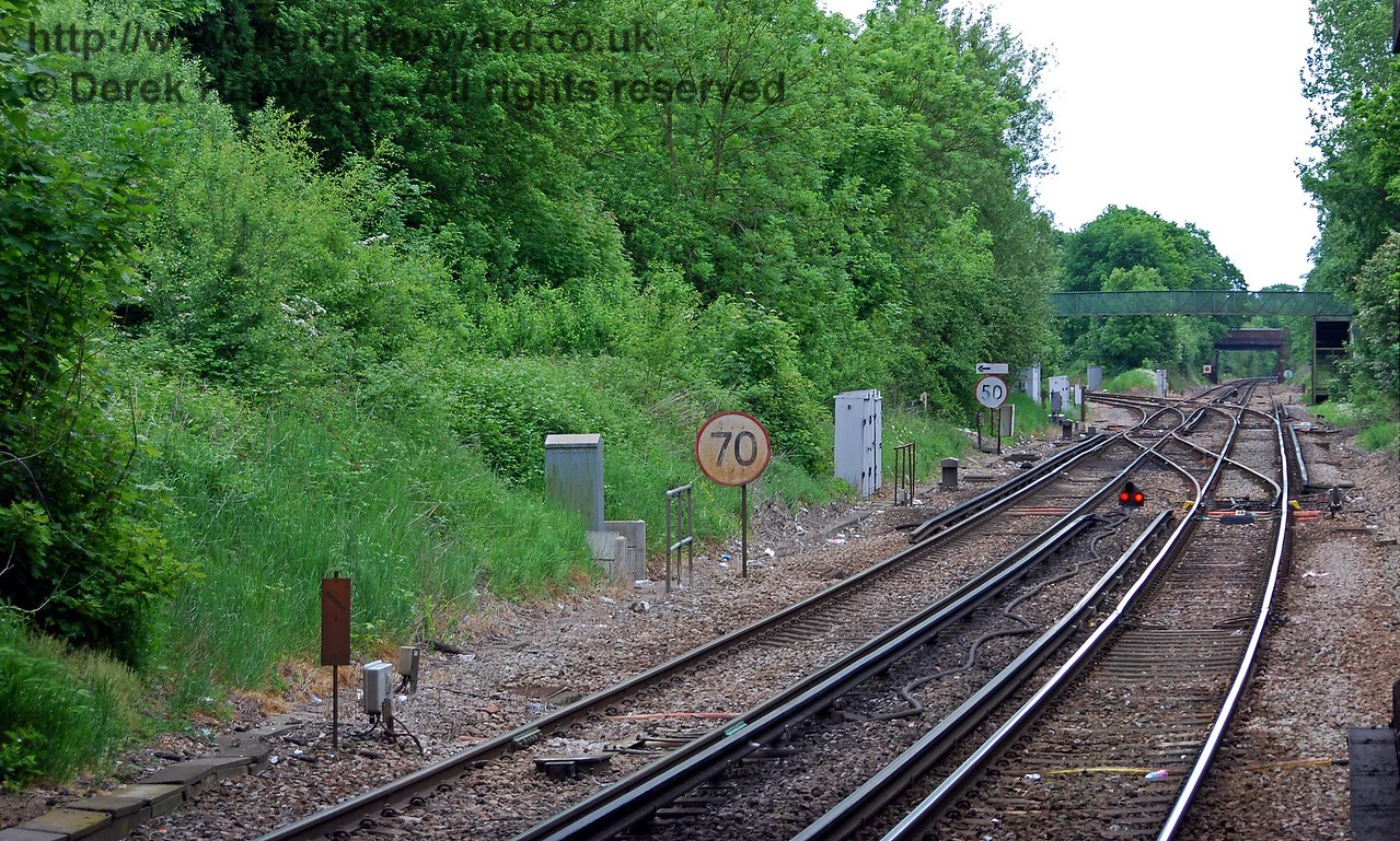Another view south through the road bridge shows the site of the southbound platform of the former Hurst Green Halt. The site is less distinct owing to the installation of more modern apparatus cases.  Access to the platforms of the Halt was from the road bridge to the south of the current station. 18.05.2008