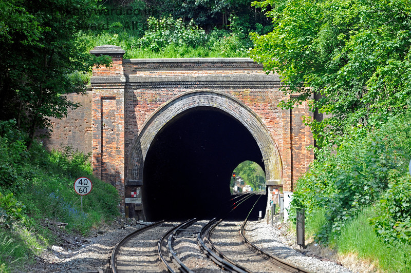Looking right through Limpsfield Tunnel from the southern portal.  There is a clear view of the next signal at the northern end.  31.05.2021 18187