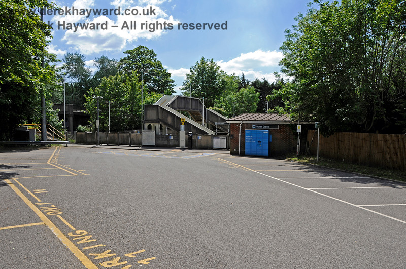 """Hurst Green Station forecourt on the eastern side of the station.  The yellow bays are """"Priority Parking"""" and blue parcel lockers have also appeared. 31.05.2021 20890"""