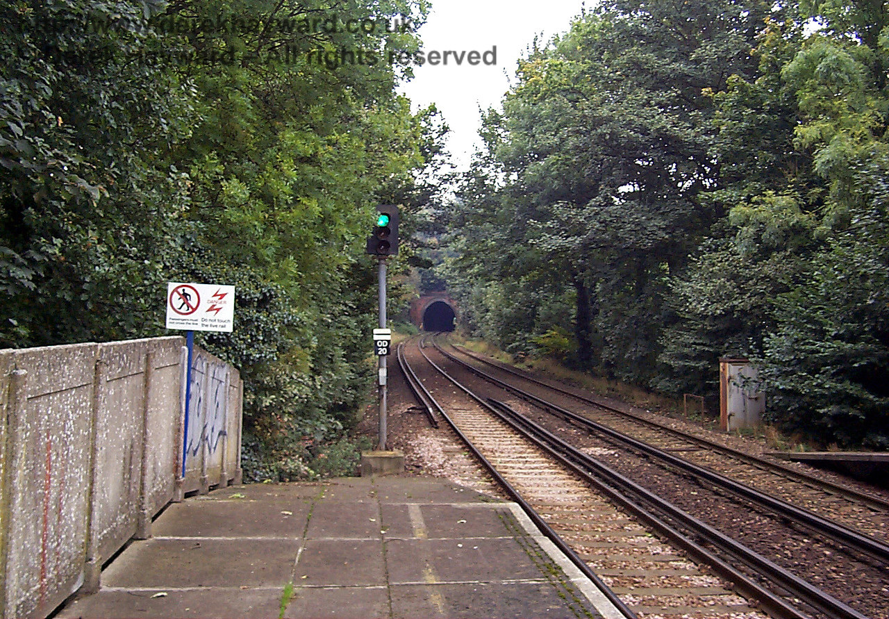 This is the same view ten years previously in 1998. The scene is typical of the line at the time, with overhanging trees, graffiti and a rusting apparatus case. 09.10.1998